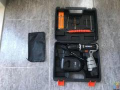 Near New Condition KOMAX Battery Drill KIT