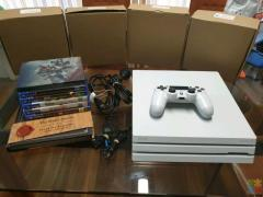 White PlayStation 4 PS4 Pro with 6 Games & Controller