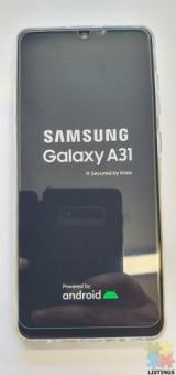 SAMSUNG A31 WITH CHARGER