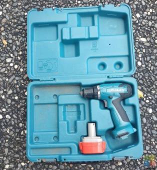 Makita drill, battery and box