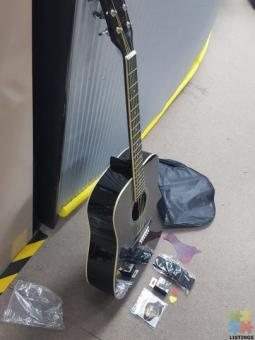Acoustic Guitar Combo: Guitar, Tuner, Strap, Strings and Picks